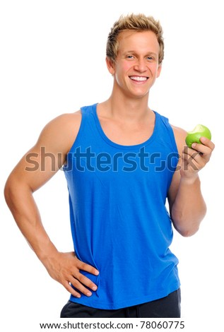 Fit young caucasian man holds a half eaten green apple, displaying a healthy lifestyle - stock photo