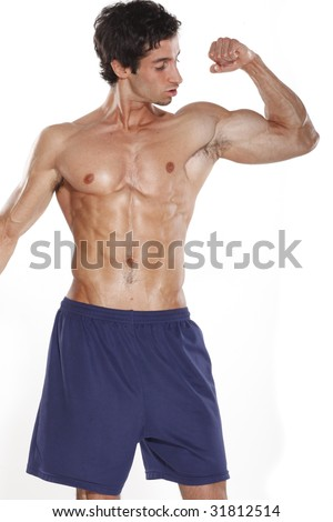 Fit Young Man in Shorts Flexing - stock photo
