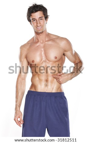 Fit Young Man in Shorts Pointing at Abs - stock photo