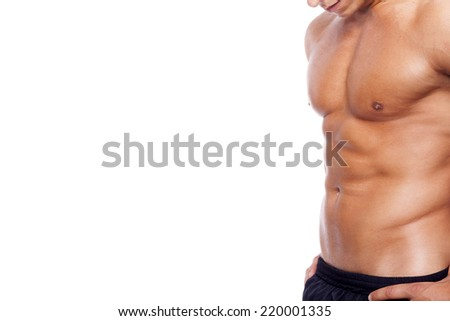 Fit young man with beautiful torso, isolated on white background - stock photo