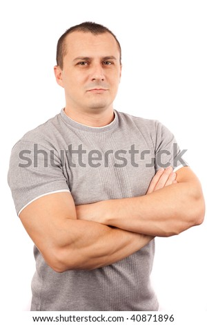 Fit young man with t-shirt and arms crossed isolated on white background - stock photo