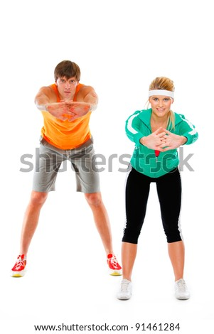 Fit young woman and man in sportswear making sport exercise isolated on white - stock photo