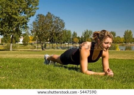 "Fit young woman doing the ""Plank"" exercise."