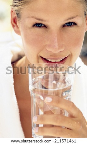 fit young woman drinking water - stock photo