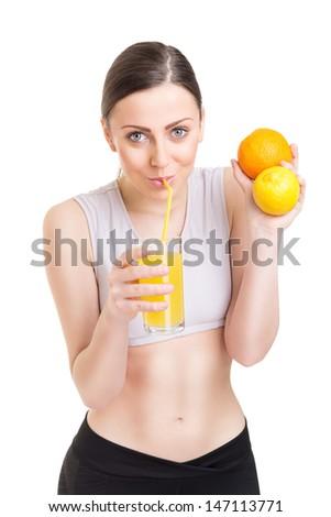 Fit young woman enjoying fresh juice - stock photo