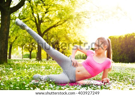 Fit young woman exercising outdoors, healthy lifestyle - stock photo