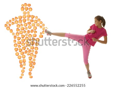 Fit young woman fighting off bad food isolation on a white background - stock photo