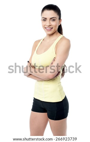 Fit young woman posing with hands on waist