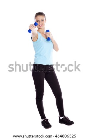 Fit young woman smiling while using dumbbells white background