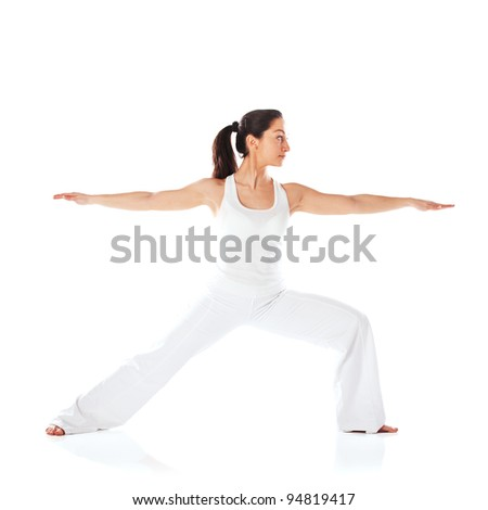 Fit young woman spending yogatic time by herself in studio.Isolation on white