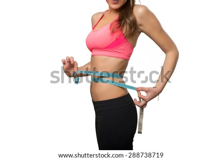 Fit young woman with a measurement scale. Over white background - stock photo