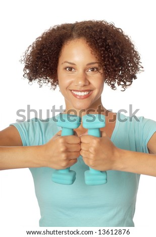 Fit young woman with small free weights - stock photo