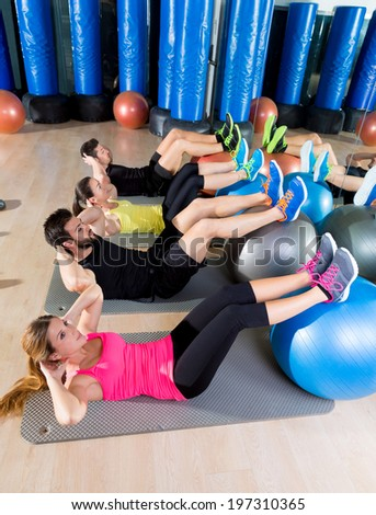 Fitball crunch training group core fitness at gym abdominal workout - stock photo