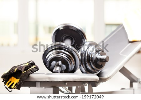 fitness accessories: dumbbells, bench - stock photo