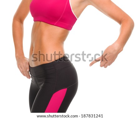 fitness and diet concept - close up of sporty woman pointing at her buttocks - stock photo