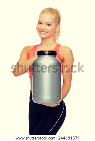 fitness and diet concept - smiling sporty woman with jar of protein - stock photo