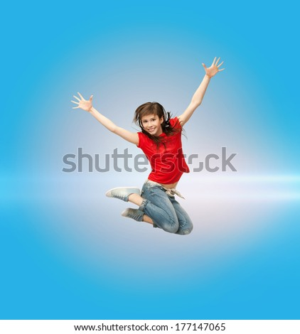 fitness and exercise concept - happy girl jumping in the air - stock photo