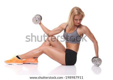 Fitness and Exercise Female Bodybuilder - stock photo