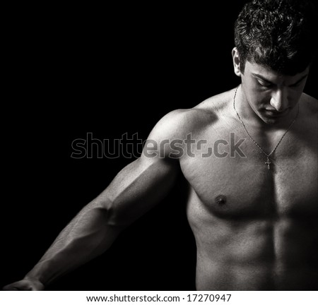 Fitness and Muscles. Muscular Man in the Dark - stock photo