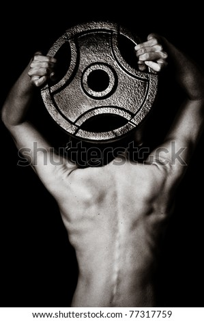 Fitness and Strength of a Woman's Back Lifting Weights - stock photo