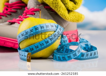 Fitness apple and measure tape composition - stock photo