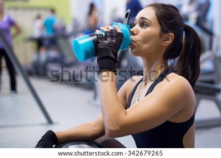 fitness athlete woman drinking water after training work out exercising. - stock photo