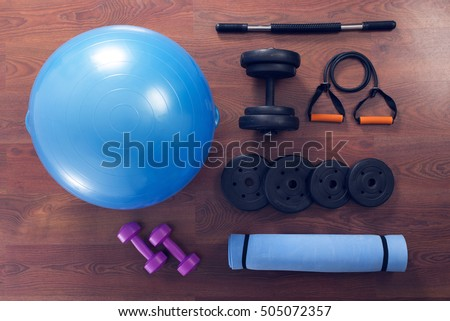 Fitness Ball Yoga Mat And Dumbbells Top View