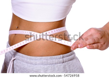 fitness body with a measurement tape - stock photo