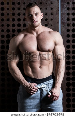 Fitness, bodybuilding. Powerful man with perfect body - stock photo