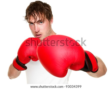 Fitness boxer boxing. Man punching with red boxing gloves isolated on white background. Fit fitness boxer sweating looking at camera. Caucasian male fitness model in his 20s. - stock photo