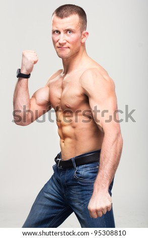 Fitness boxer strong macho man doing aggressive self-defence