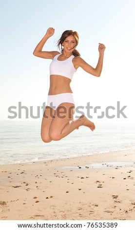 fitness brunette woman exercise on the beach - stock photo