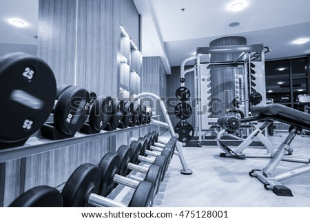 Fitness club in luxury hotel interior.