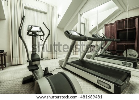 Fitness club in luxury hotel interior, GYM concept as background.