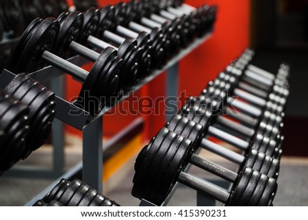 Fitness club weight training equipment gym  - stock photo