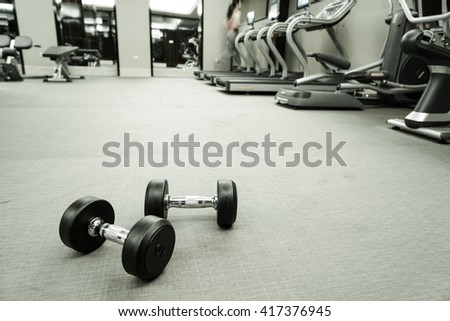 Fitness club weight training equipment gym concept.