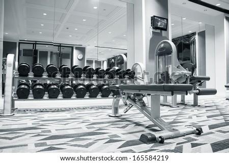 Fitness club weight training equipment gym modern interior - stock photo