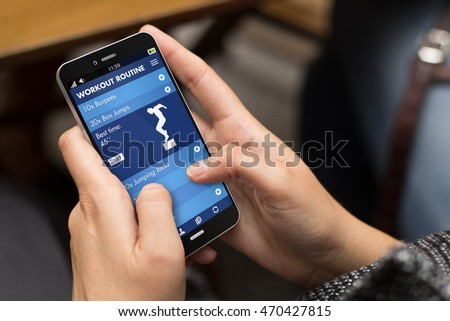 fitness concept: girl using a digital generated phone with fitness app on the screen. All screen graphics are made up.