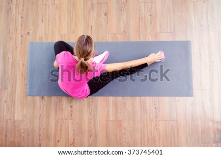 Fitness concept. Top view of woman exercising on the mat. - stock photo