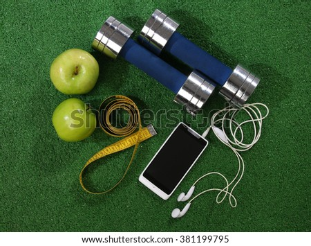 Fitness concept. Various elements over a grass background