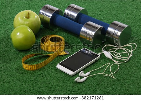 Fitness concept. Various elements over a grass background - stock photo