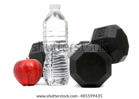 fitness concept, weights water and a red apple isolated on white background
