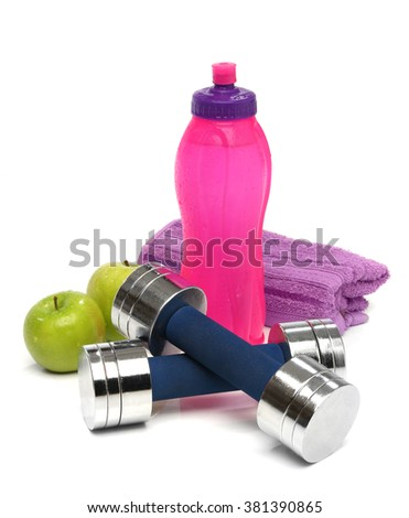 Fitness concept with a bottle of water, a towel, dumbbells and apples isolated
