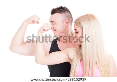 Fitness couple flexing biceps. Man and woman aerobic trainers on white background - stock photo