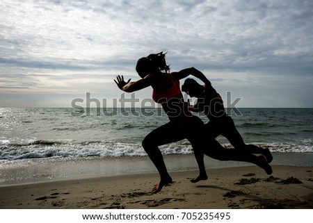 fitness couple running and workout on the beach when sunset.