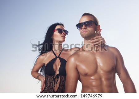 Fitness couple with oil on the skin - stock photo