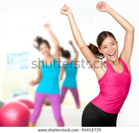 Fitness dance class aerobics. Women dancing happy energetic in gym fitness class. - stock photo