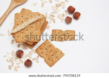 Fitness Diet cookies Isolated on White Background with oats and nuts. Wooden spoon. Top View.