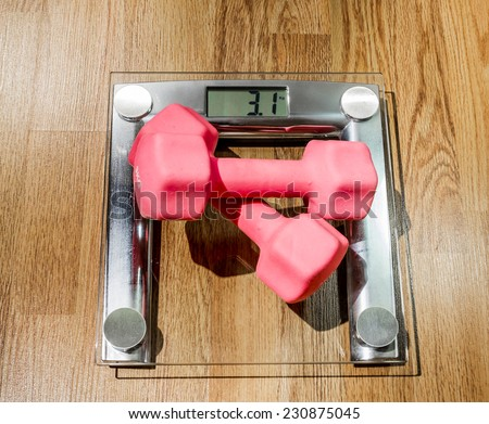 Fitness dumbbell weights at home against the backdrop of a parquet - stock photo