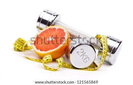fitness dumbbells  and fruits - stock photo